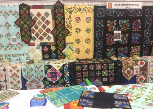 Anna's Amazing Applique quilts on display at Quilt Market